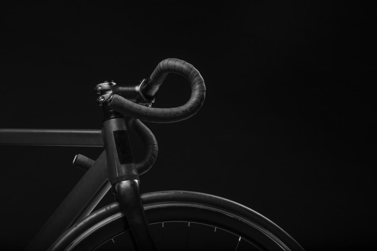 black road bicycle handle with black background