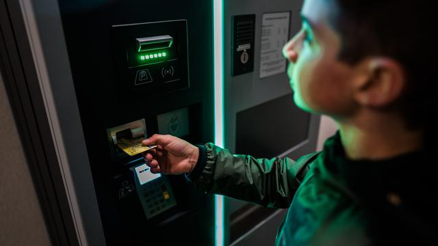 A person using an ATM. ATM placement services are essential to the success of your business.