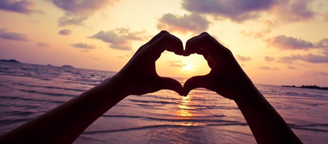 heart hands ocean sunset.jpg