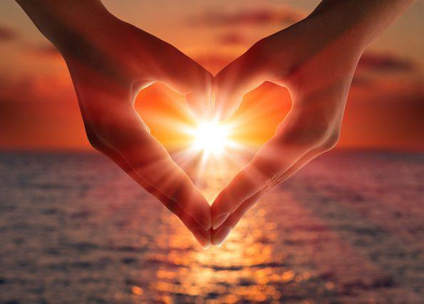 hands heart ocean sunset upside down hands.jpg