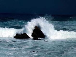 Waves crashing on a rock.