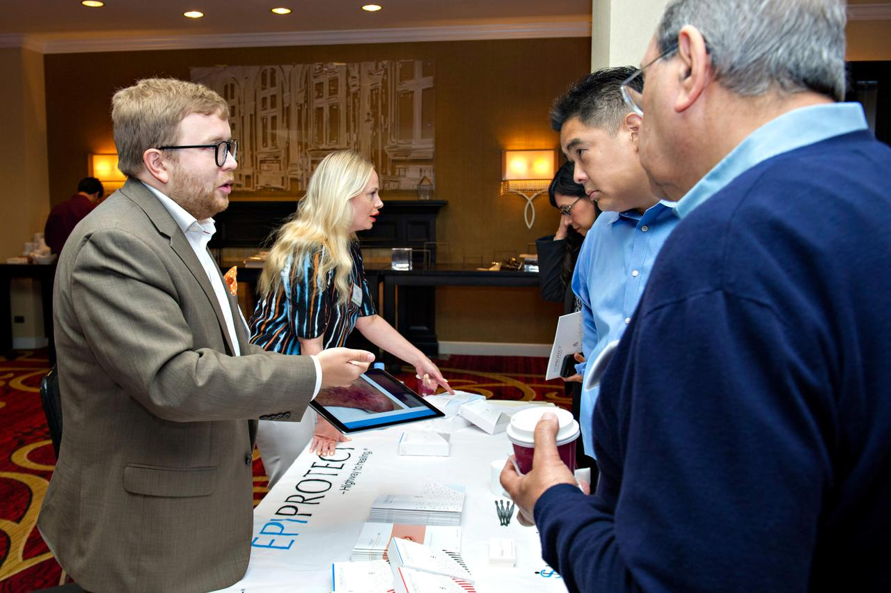 A speaker giving audience members and up-close-and-personal look at their presentation on a tablet.