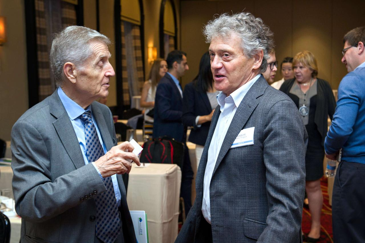 Two men discussing the knowledge they've gained.