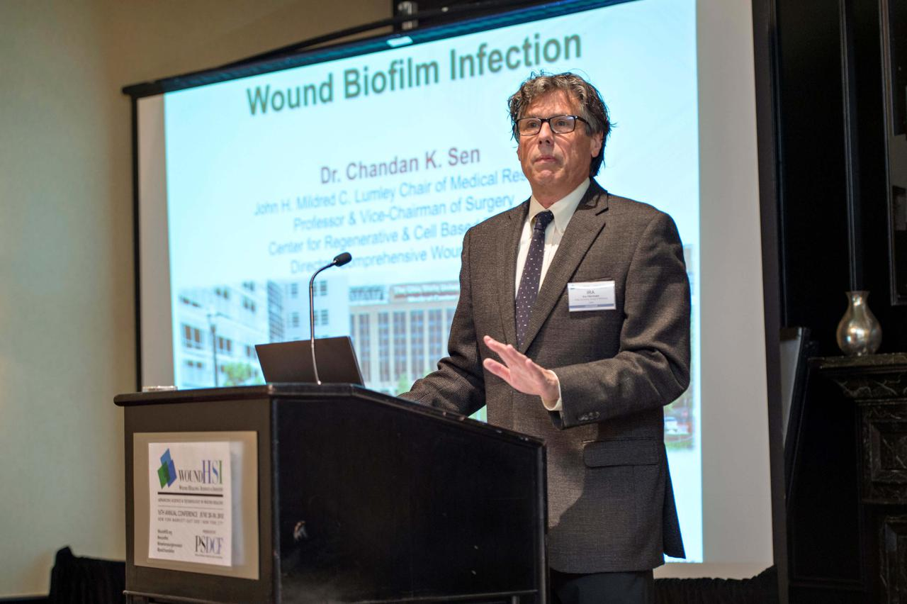 An expert explaining wound biofilm injections at one of our wound care trade shows.