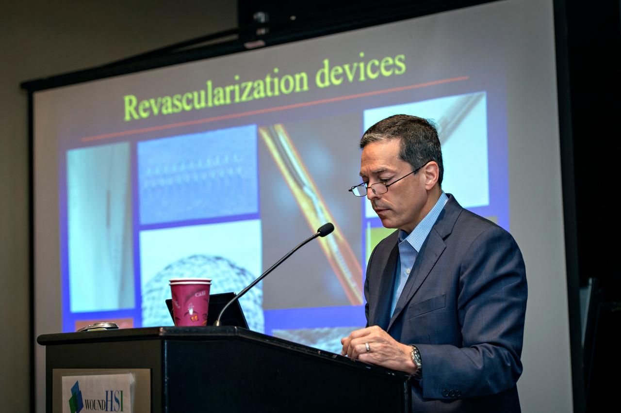 A speaker providing an innovative approach at a vascular medicine conference.