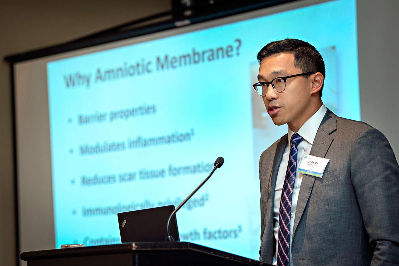 A man providing wound healing education about amniotic membranes.