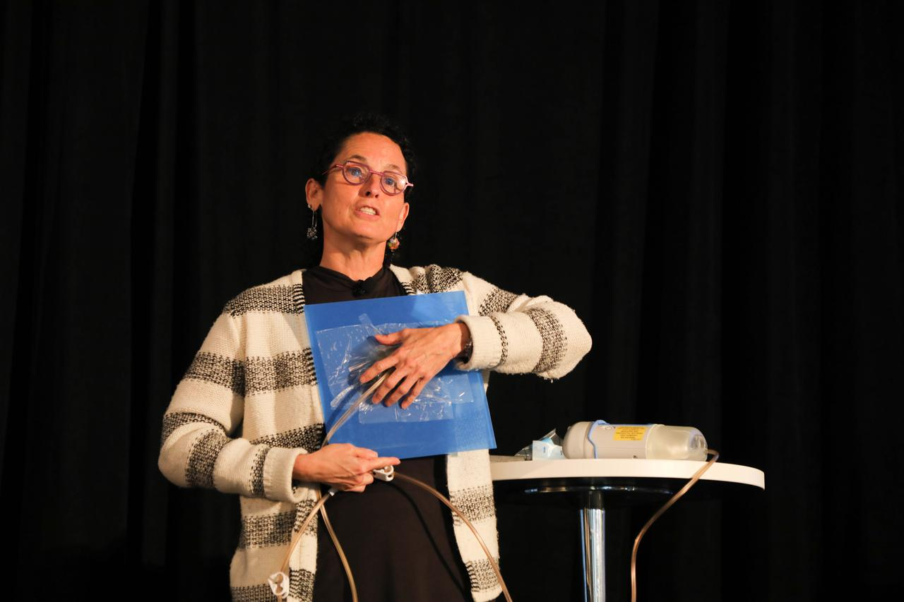 A woman demonstrating a medical procedure at one of our wound care seminars.
