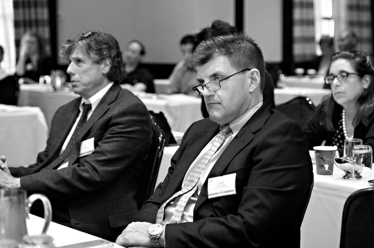 Two audience members listening intently to a presentation being given at a wound care conference in 2021.
