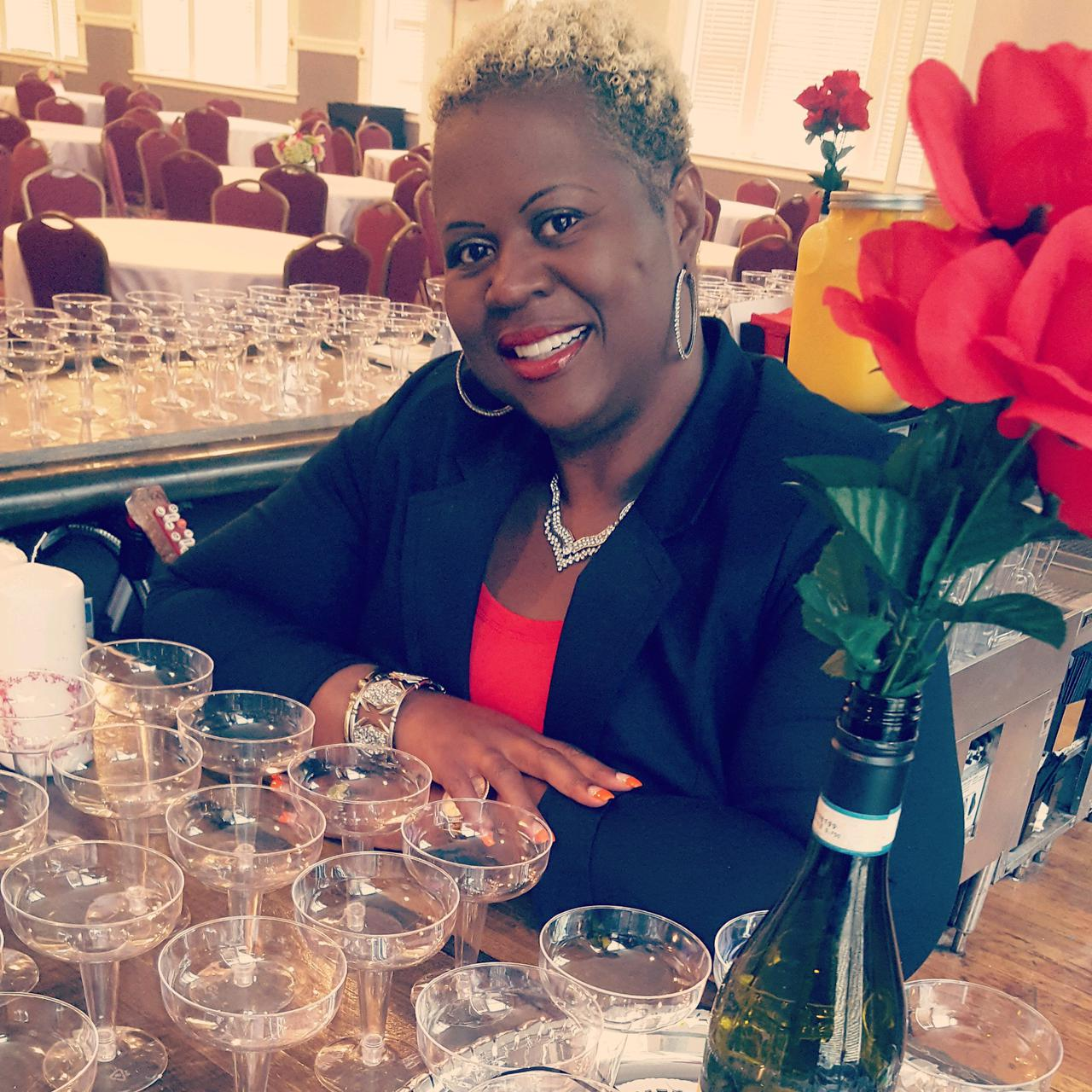 bartender on board ceo tanya foster with champagne glasses