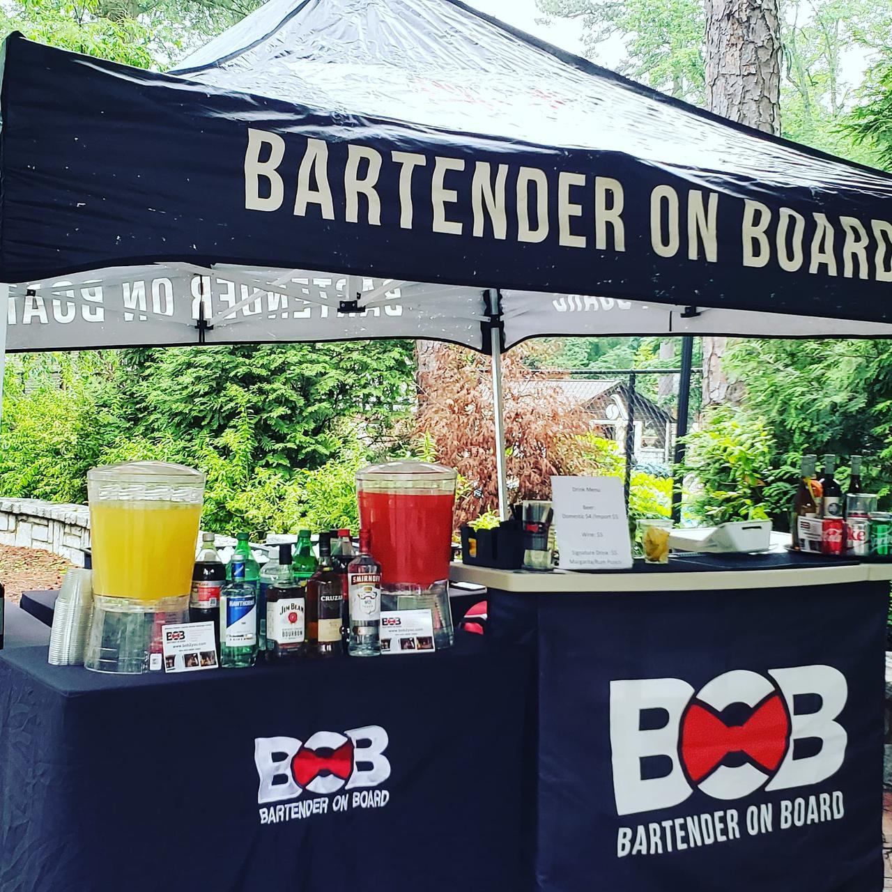 bartender on board mobile bartending tent at event in atlanta metro area