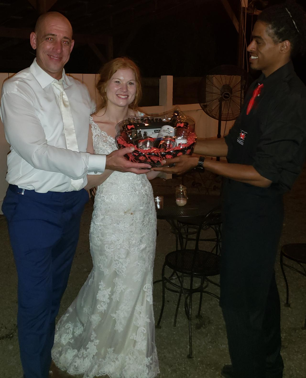 bartender offering tray of drinks to bride and groom at wedding