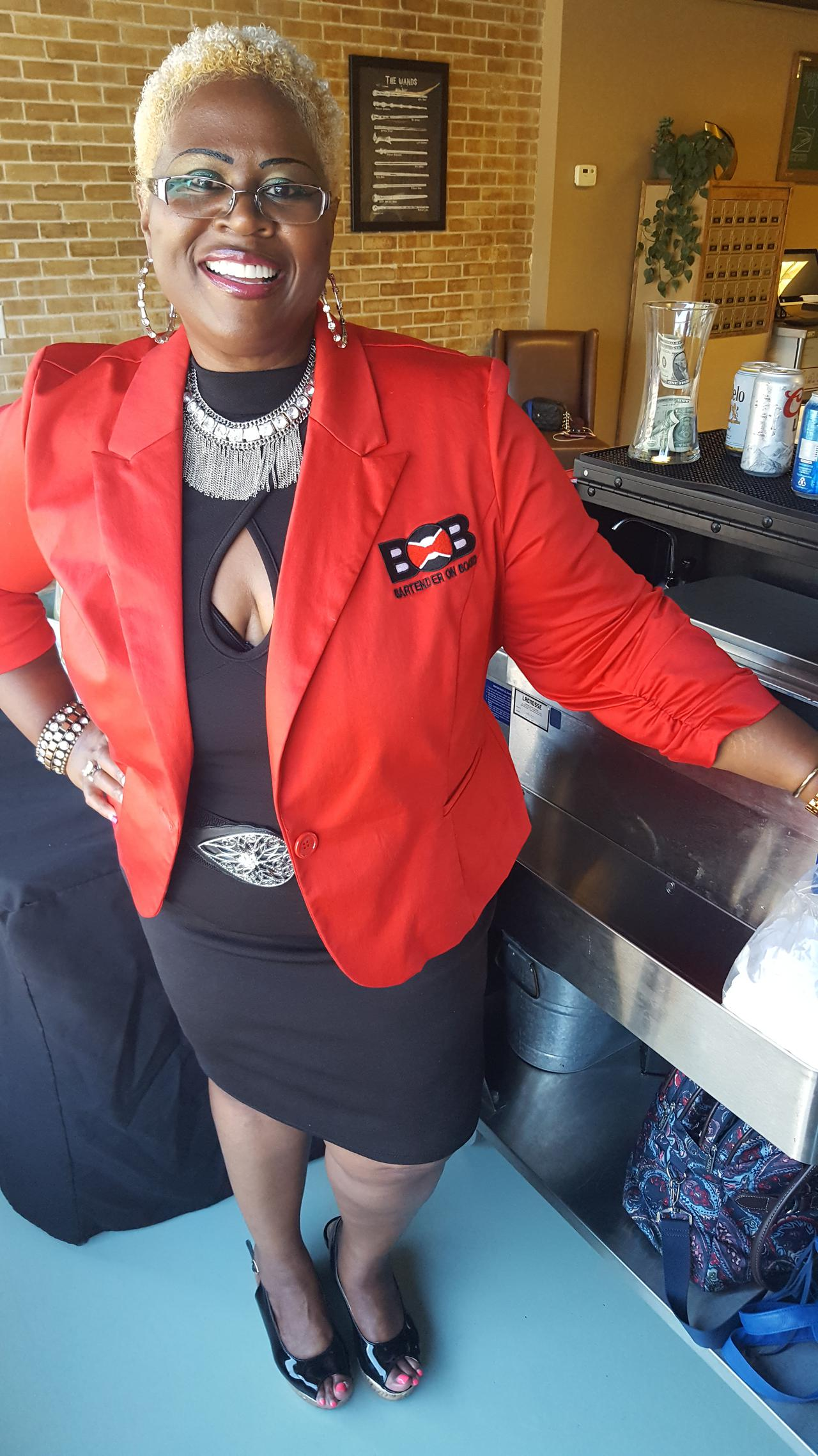 bartender on board ceo tanya foster poses in her red blazer