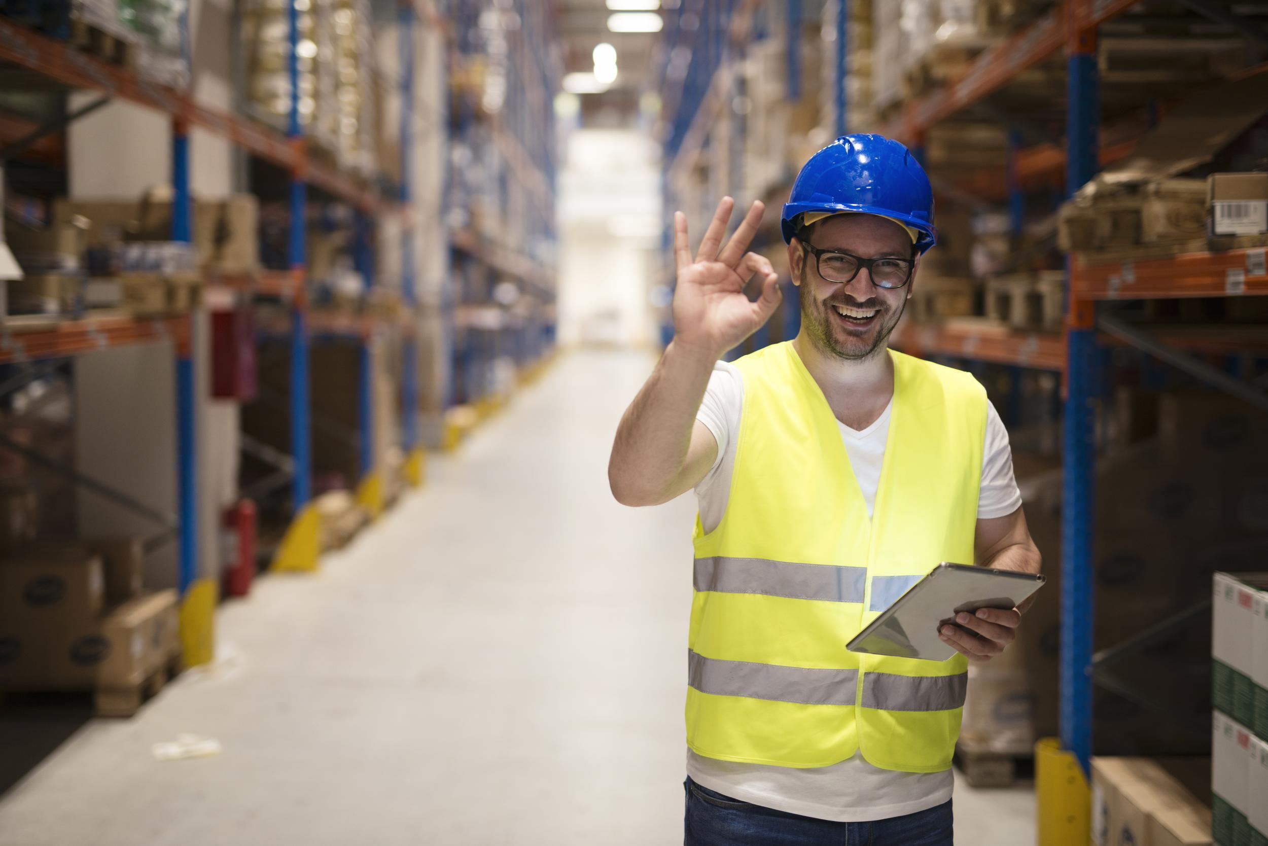 warehouse-worker-standing-large-storage-center-showing-ok-hand-gesture-satisfied-delivering-goods.jpeg
