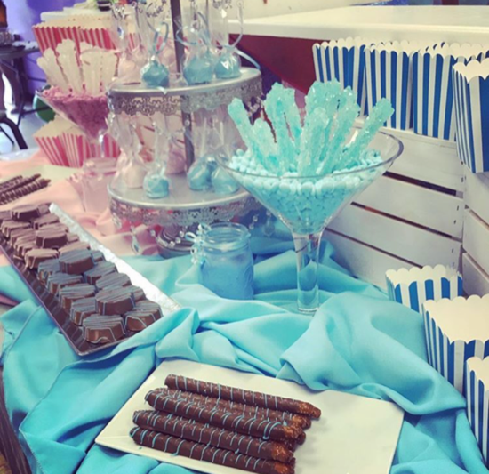 pink & baby blue gender reveal candy table.png