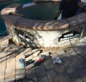 Repairing broken return lines inside a spa wall