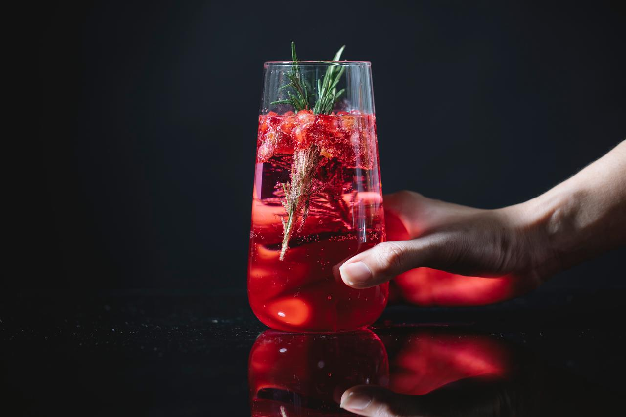 A refreshing fruity drink with ice, real fruits, and other ingredients.