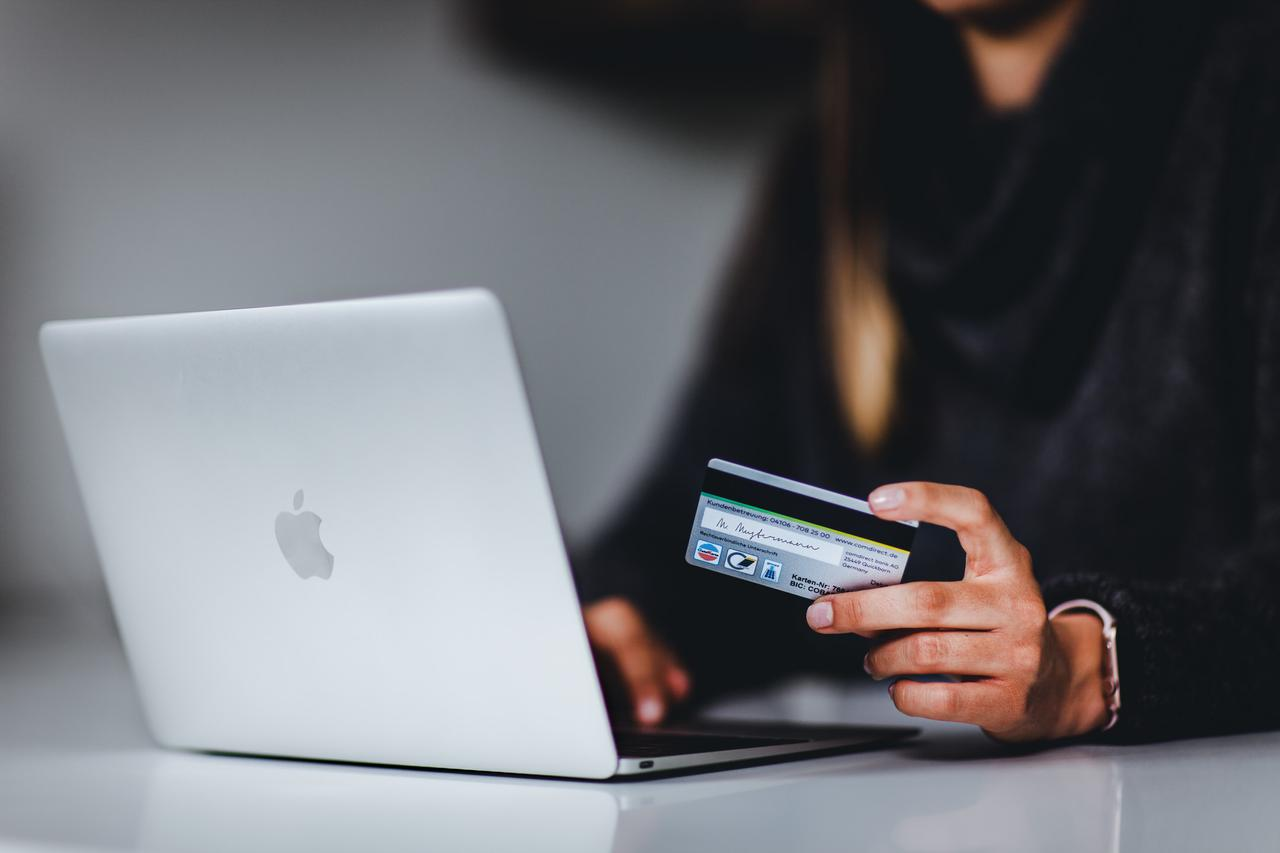 A woman who enters her bank details while shopping online.