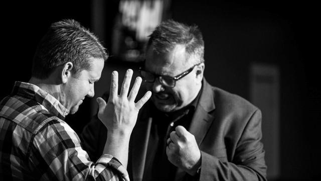 pastor mike praying.jpg