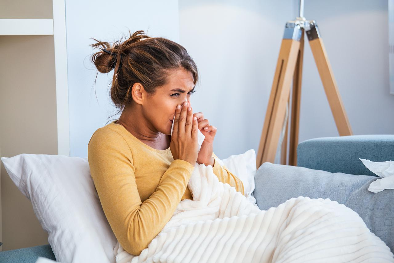 woman-caught-cold-flu-sneezing-into-tissue.jpg