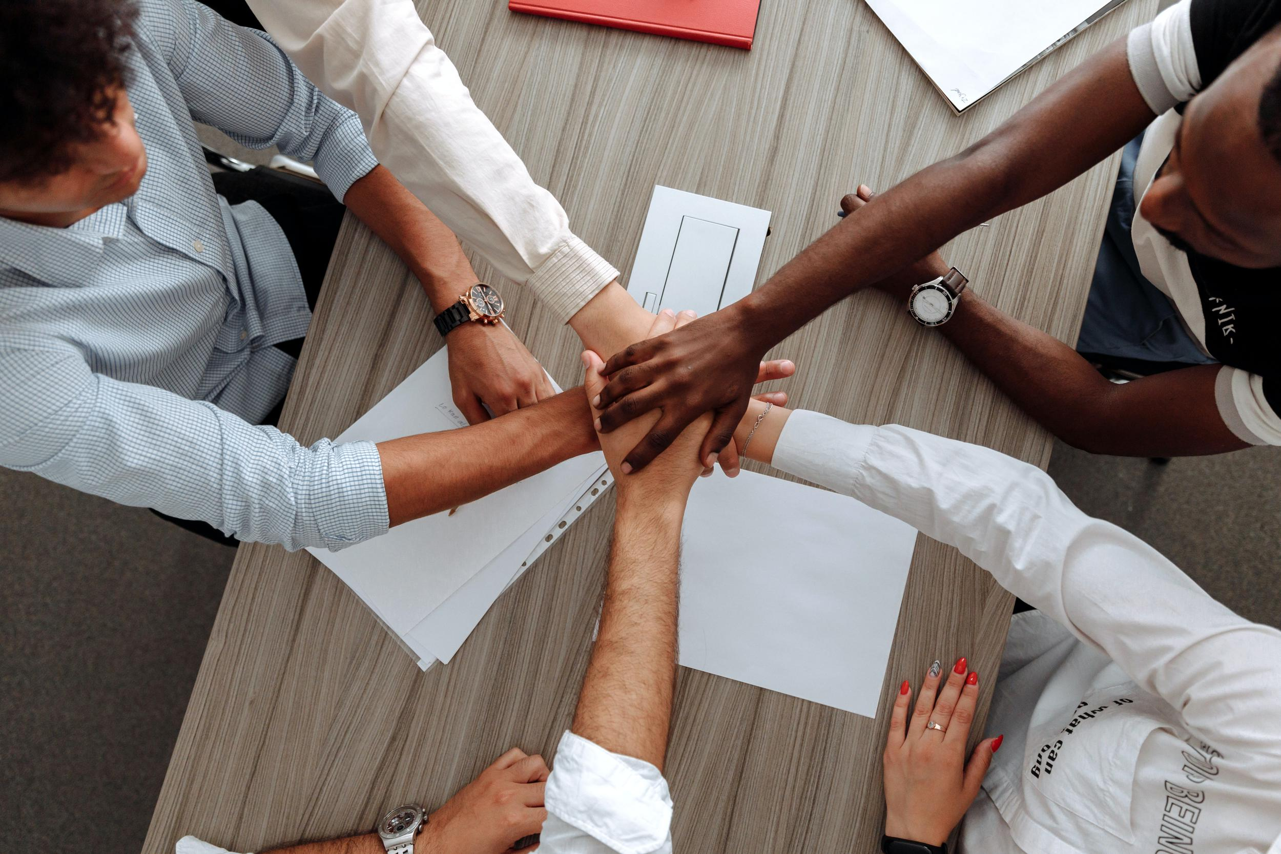 A small business consulting team doing a handshake