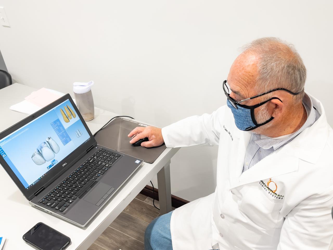 A dentist using his computer.