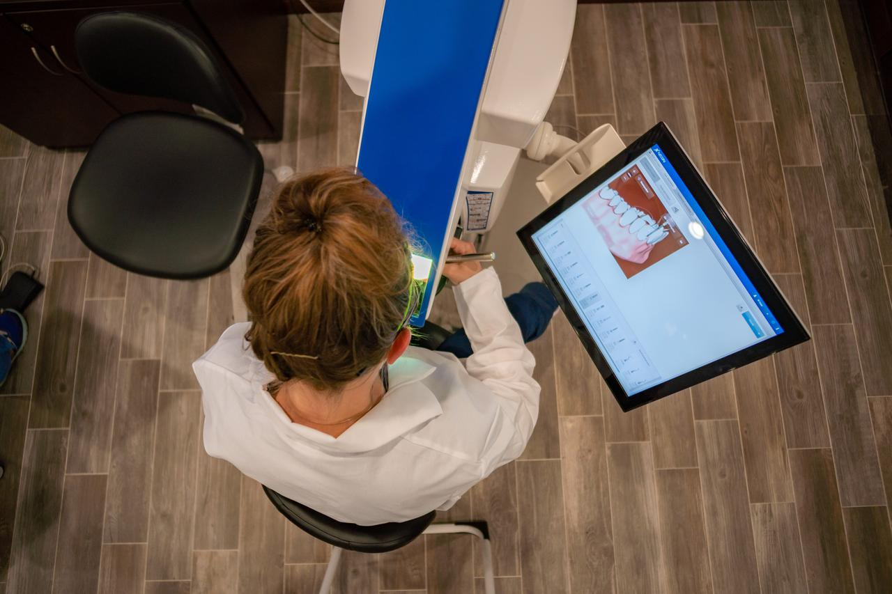 Overhead shot of a dentist in a chair.