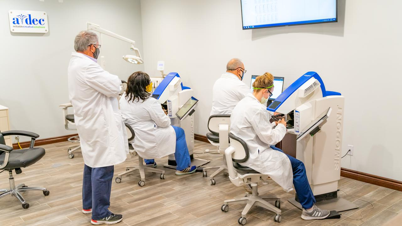 Group of dentists training in an office.