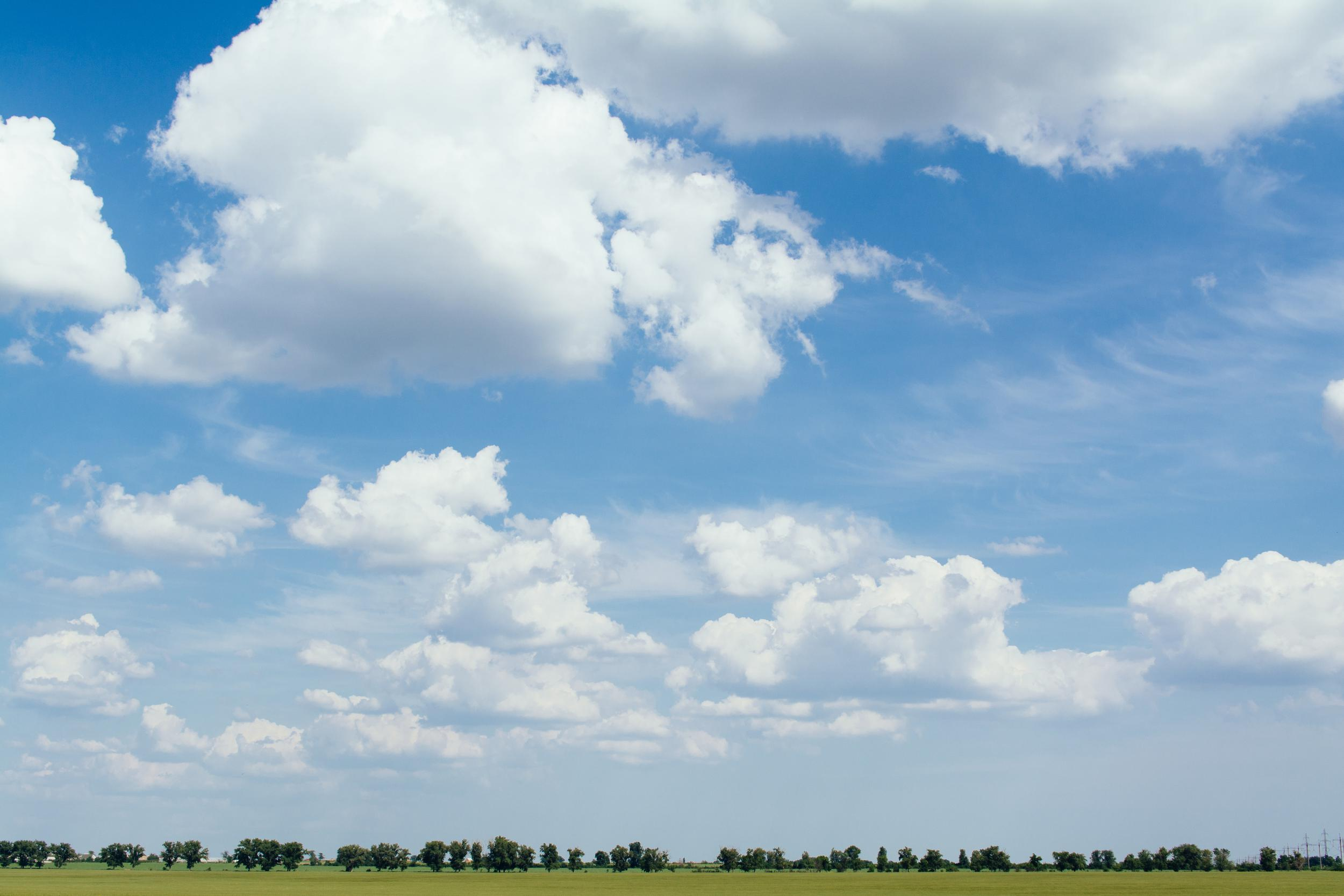 image of a blue sky with lots of clouds in it