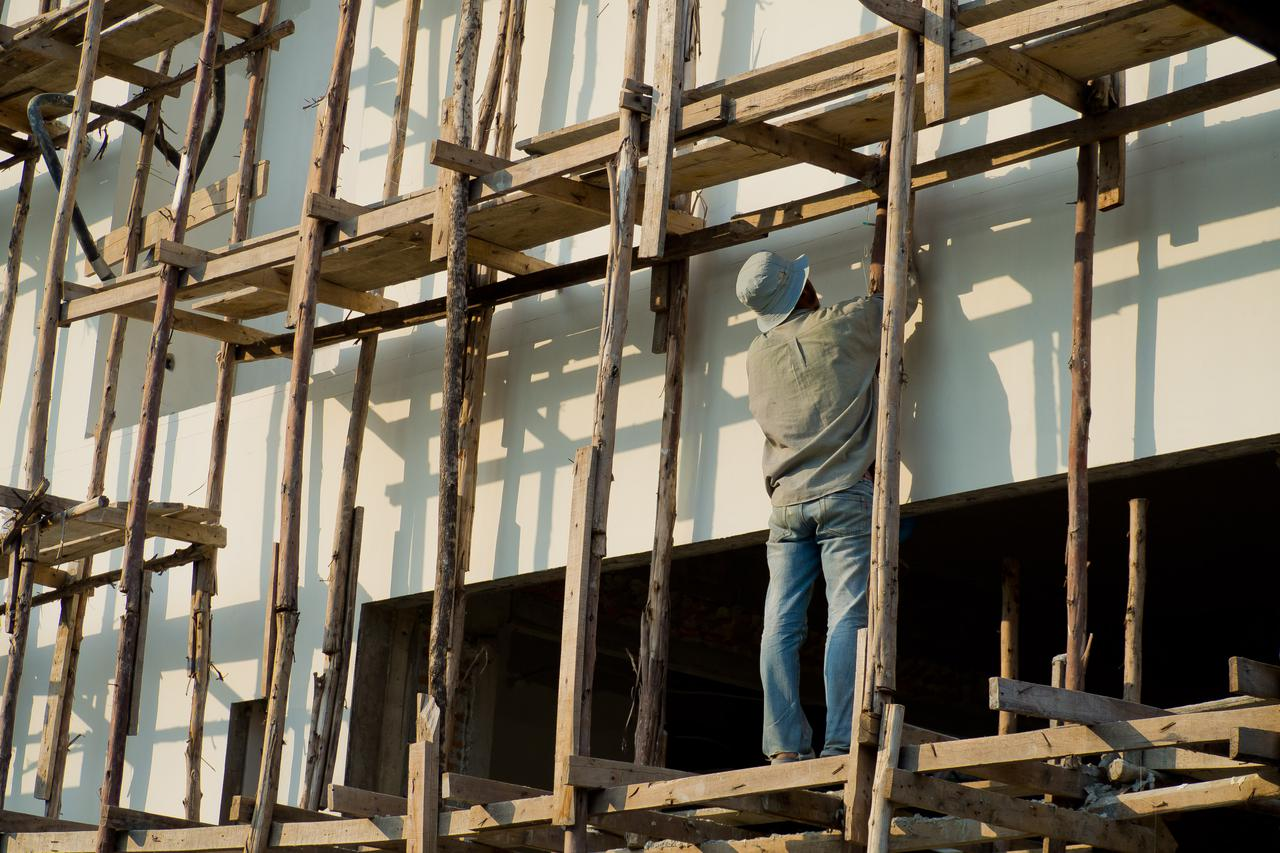 painted-workers-painted-white-wall.jpg