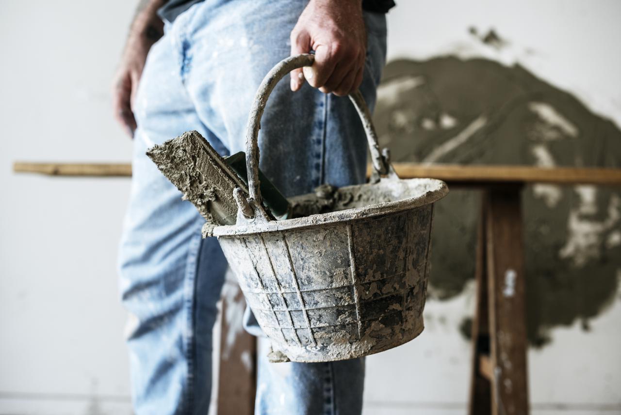 handyman-holding-basket-cement-construction.jpg