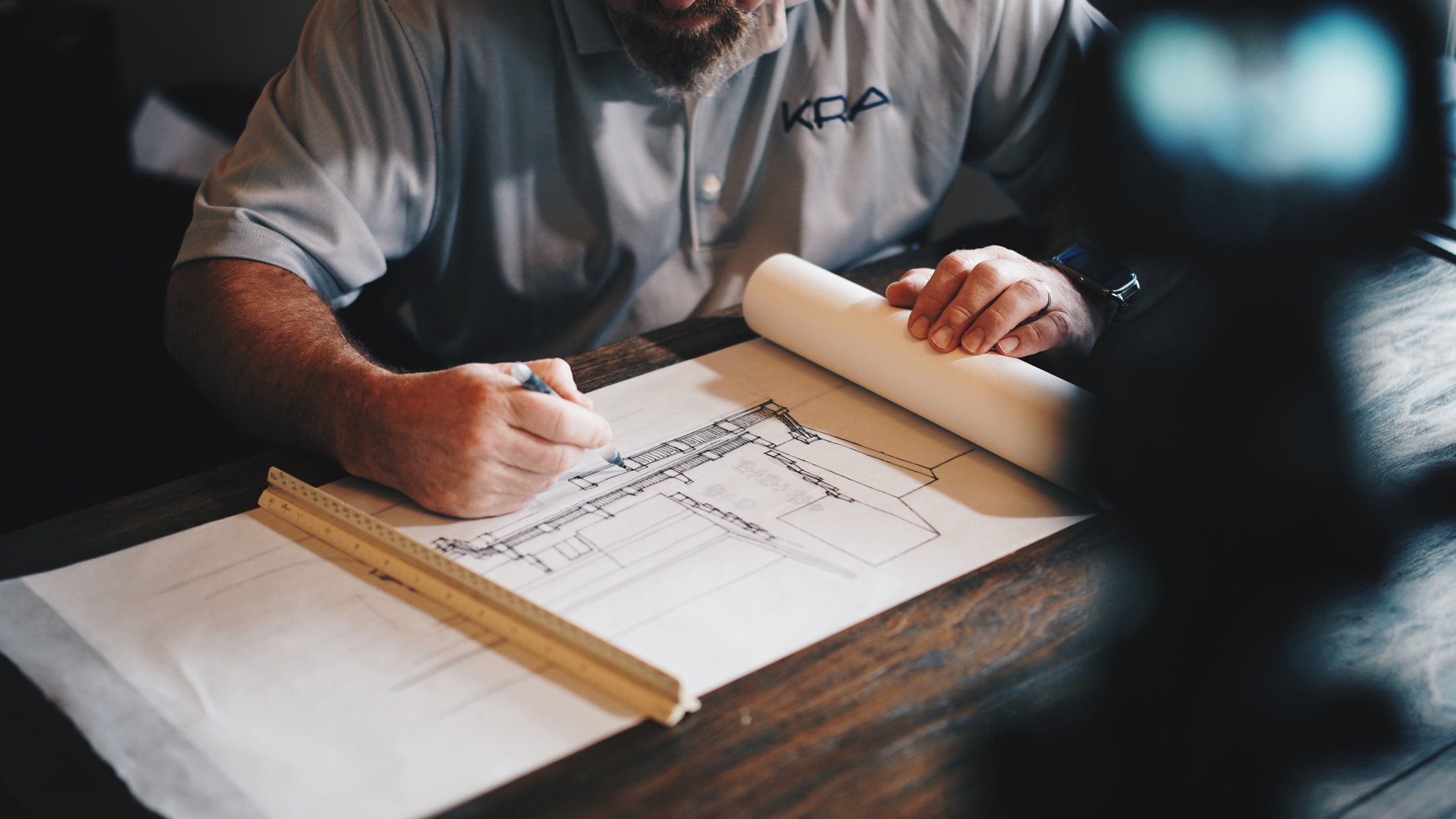 Architect reviewing construction designs