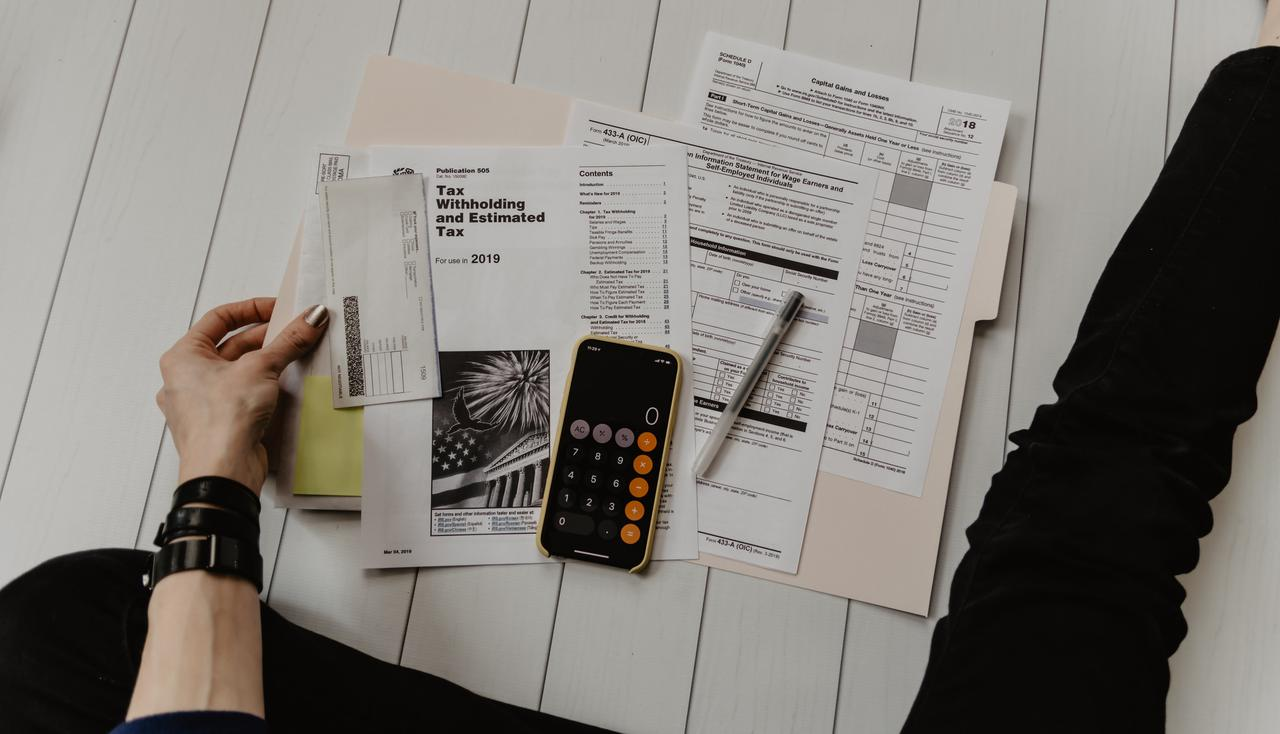 A person reviewing their information and documents to file their taxes. These proactive habits are the best way to avoid a CRA late filing penalty.