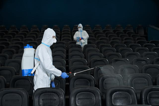 workers-cleaning-cinema-hall-with-special-disinfec-3ln4xhd.jpg