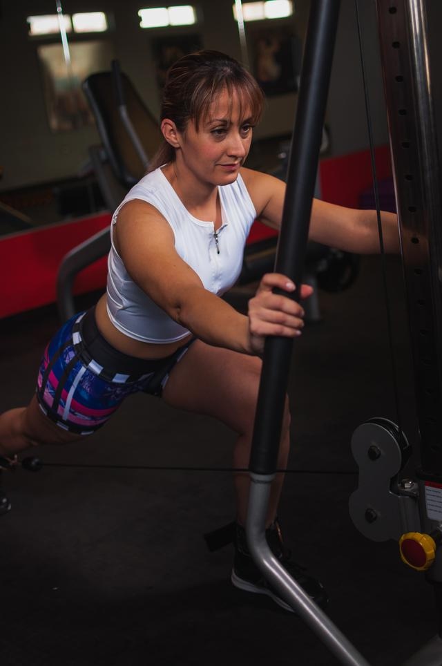 photo-of-woman-working-out-using-gym-equipment-inside-gym-1717097.jpg
