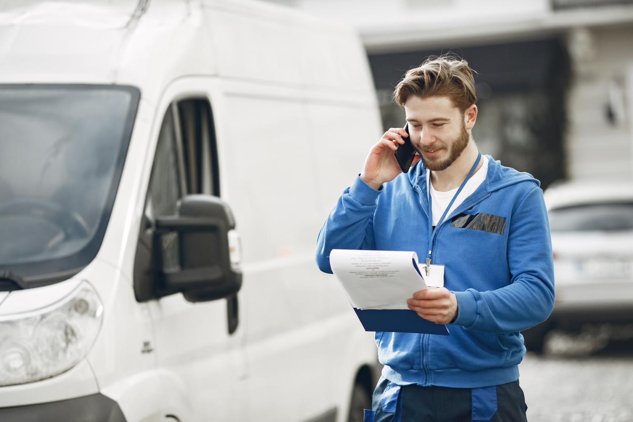 man-by-truck-guy-delivery-uniform-man-with-clipboard.jpg