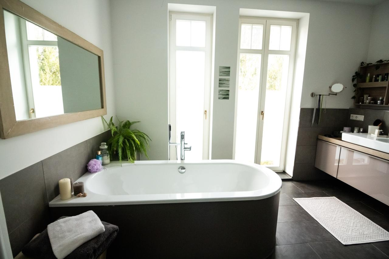 Bathroom with huge bathtub.