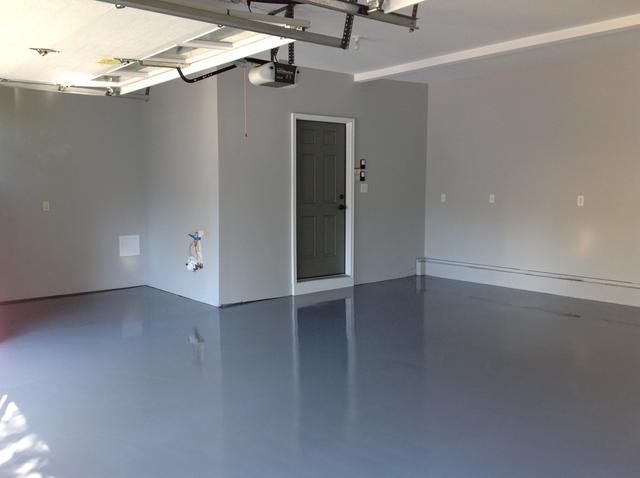 concrete flooring contractors work of garage floor primer coat