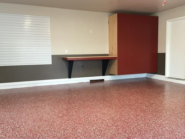 garage with red floor and cabinets