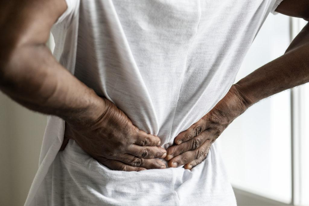 person experiencing back pain