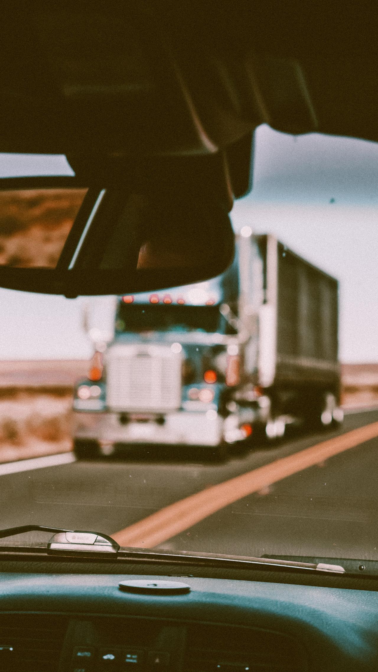 Blurred truck approaching a car