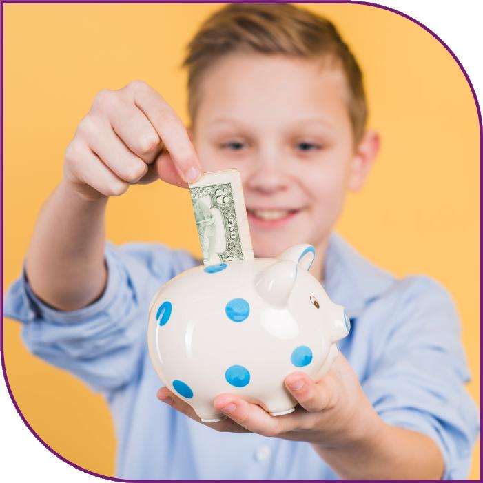 Kid putting money into a piggy bank.