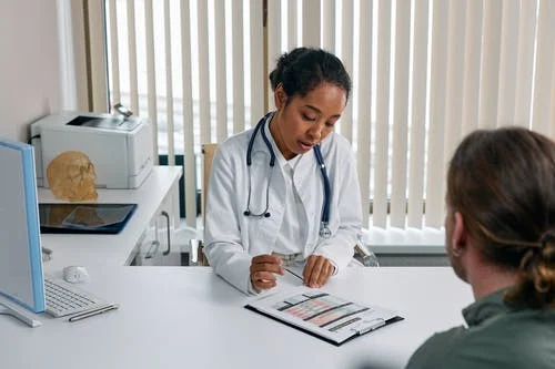 a doctor talking to a patient.png