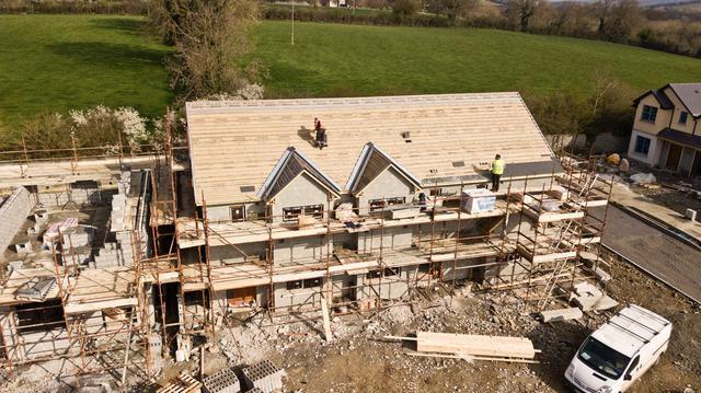 aerial-photo-of-brown-3-story-house-2098624.jpg
