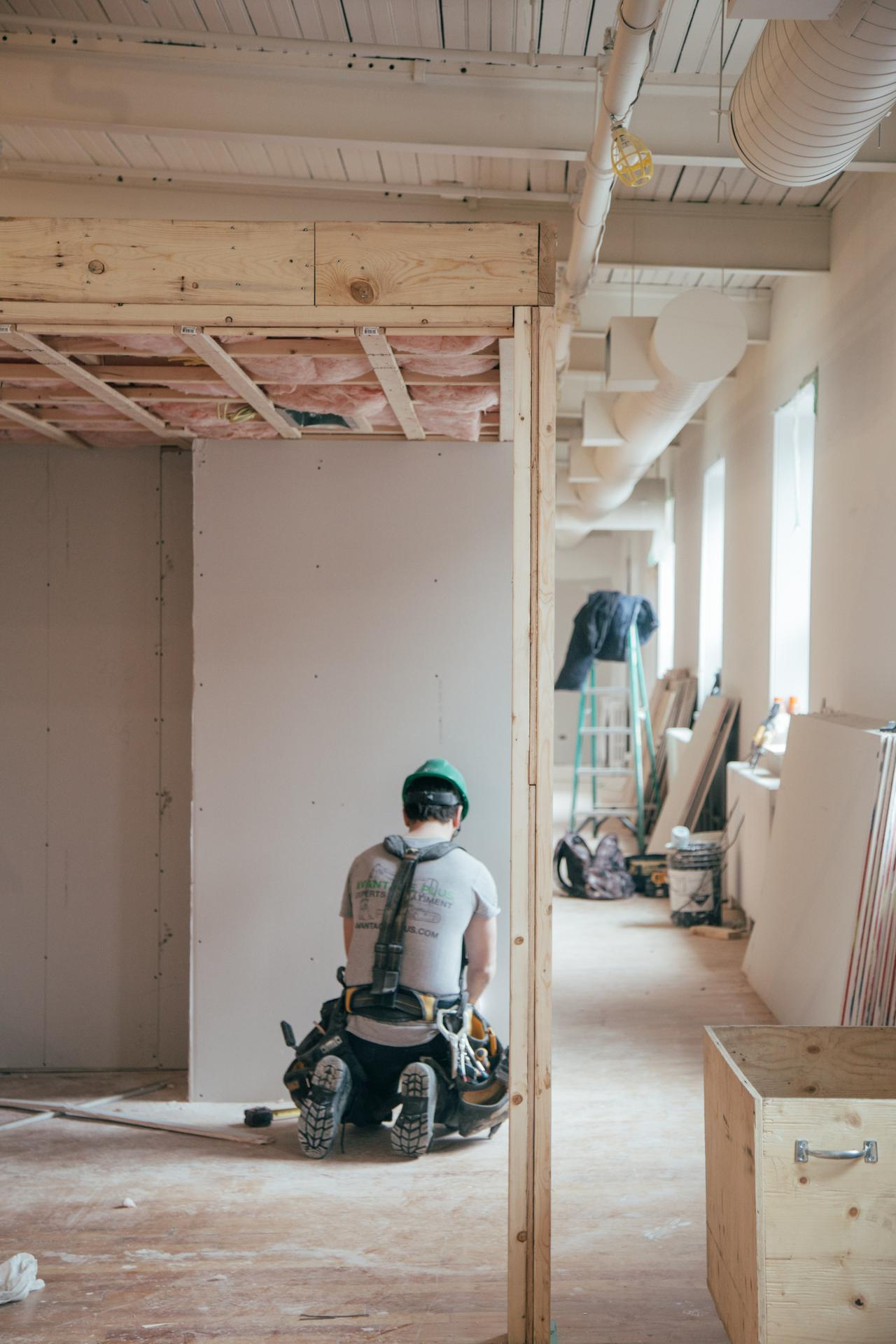 Photo of a residential renovations expert working on a home.