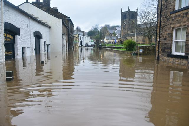 flooded buildings in need of water mitigation services