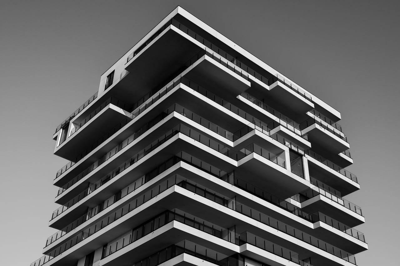 concrete building in greyscale