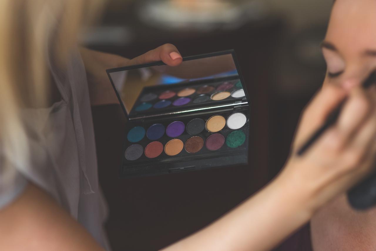 make up artist applying eyeshadows