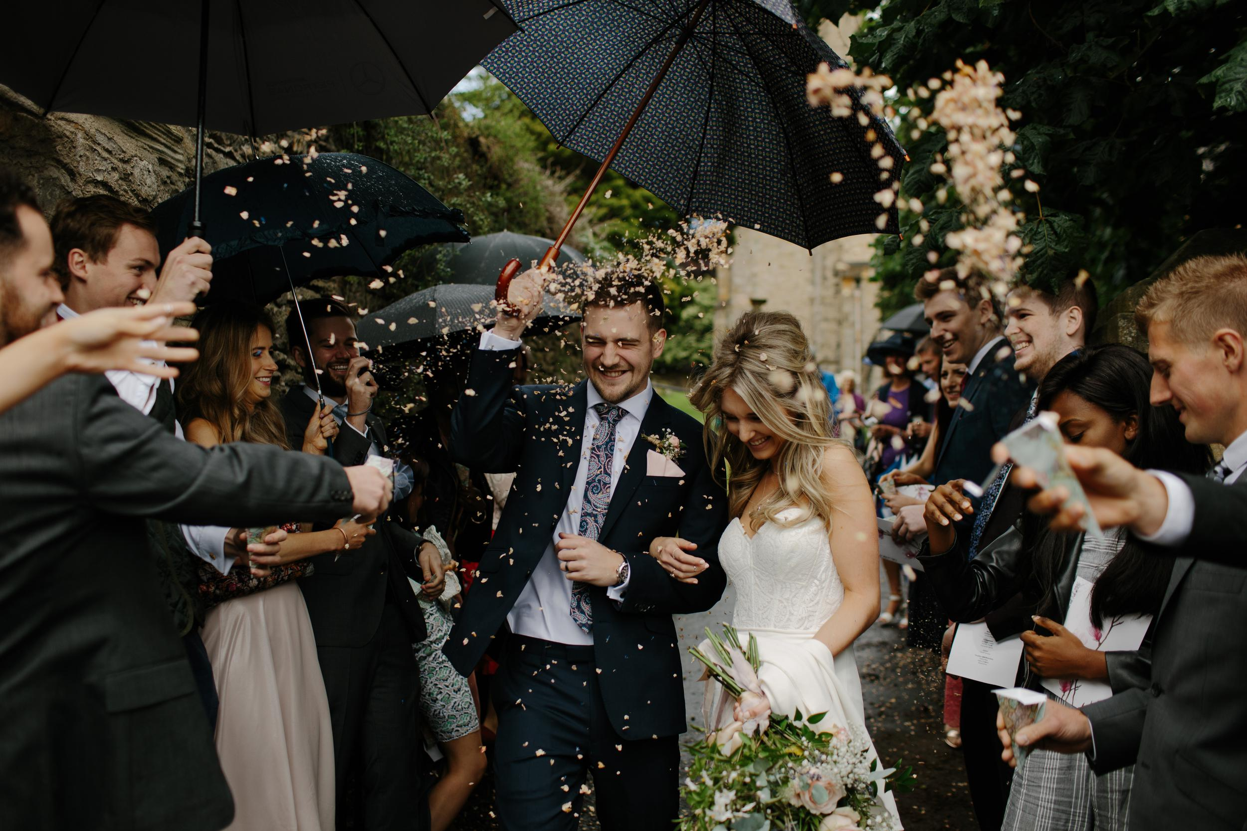bride and groom on their wedding day with their guests