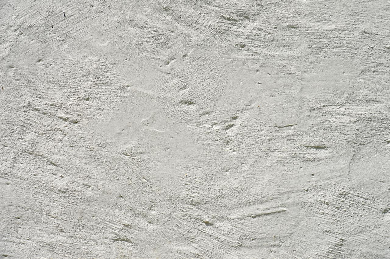 Image of stucco wall with clear stucco sealer
