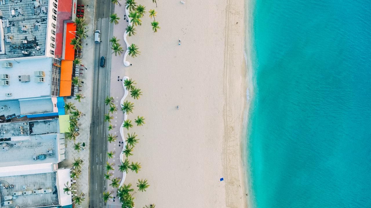 blue ocean and white sand top view